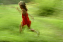 Girl running. On green backgroun - motion effect stock photography