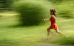 Girl running. On green backgroun - motion effect stock images