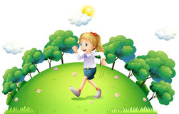 A girl running above the hill Stock Photos