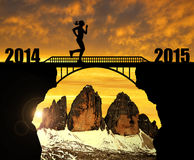 Girl running across the bridge to the New Year 2015 Stock Photography