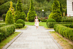 Girl running along the alley Royalty Free Stock Photo