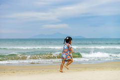 Girl running along the China Beach in Danang in Vietnam Royalty Free Stock Images
