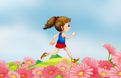 A girl running along the hill with a garden Stock Photo