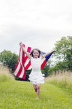 Girl running with American flag Stock Photos