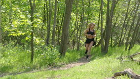 A girl is running around in the woods stock video footage