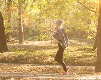 Girl running in the autumn park. Healthy concept stock images
