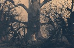 Girl running away from ghost tree in creepy forest stock images
