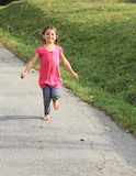 Girl running barefoot Royalty Free Stock Images