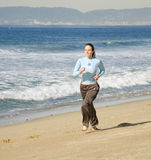 Girl Running at the Beach Stock Photo