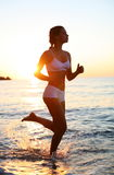 Girl is running on the beach. Stock Images