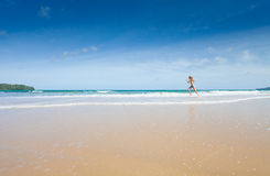 Girl running on beach Royalty Free Stock Photos