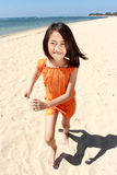 Girl running in the beach Royalty Free Stock Images