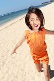 Girl running in the beach Stock Image