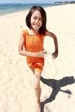 Girl running in the beach Stock Photography