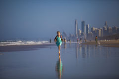 Girl Running on the Beach Stock Images