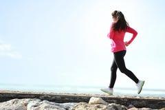 Girl running on the beach Stock Photos