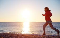 Girl running on the beach Royalty Free Stock Photos