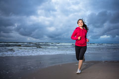 Girl running on beach stock image