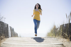 Girl Running On Beach Walkway Royalty Free Stock Photo