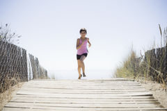 Girl Running On Beach Walkway Stock Photos