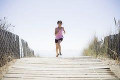 Girl Running On Beach Walkway Stock Photos