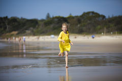 Girl Running on the Beach Stock Photography