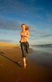 Girl running on beach Royalty Free Stock Image
