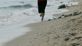 Girl running at beach stock video footage