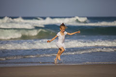 Girl Running on the Beach Royalty Free Stock Images