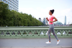 Girl running in the city Royalty Free Stock Photos