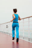 Girl running on cruise liner deck Royalty Free Stock Image