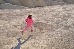 Girl running down dirt path Royalty Free Stock Photos