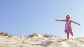 Girl Running Down Sand Dune Royalty Free Stock Image