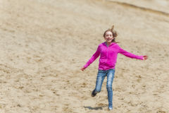 Girl running down a sand dune Royalty Free Stock Images