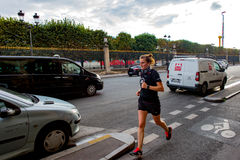 Girl running down the street of Paris Royalty Free Stock Photography