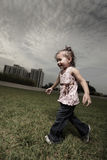 Girl running through the field Royalty Free Stock Images