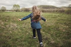 Girl running in the field Stock Image