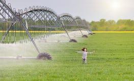 Girl running on field Stock Photos