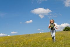 Girl running with flowers. Girl running happy with flowers Stock Images
