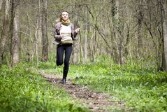Girl running in forest Stock Photography