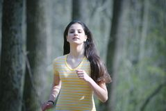 Girl Running in Forest stock photo