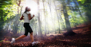 Girl Running in forest Stock Images