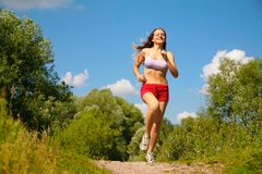 Girl running in forest Stock Photos