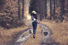 Girl running in  forest Stock Image