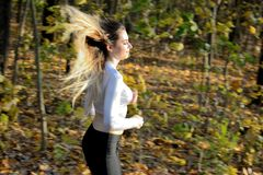 Girl running in the forest stock photos