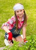 Girl running in the garden Royalty Free Stock Images