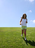 Girl running on grass royalty free stock photography