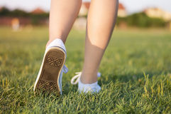 Girl running on the grass Royalty Free Stock Photos