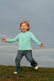 Girl running on grass hill Stock Photo