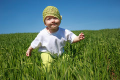 Girl running on the grass Stock Photography